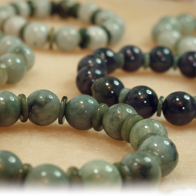 Green jade bracelets, with different hues of green, including the rare moss colour.